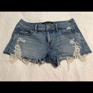 Express distressed blue jean shorts.